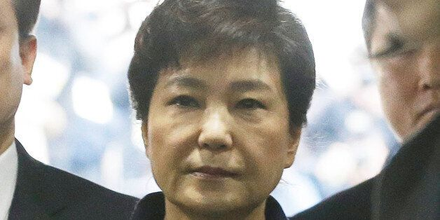 Ousted South Korean President Park Geun-hye arrives for questioning on her arrest warrant at the Seoul...