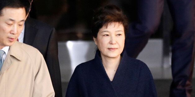 South Korea's ousted leader Park Geun-hye leaves a prosecutor's office in Seoul, South Korea, March 22,...