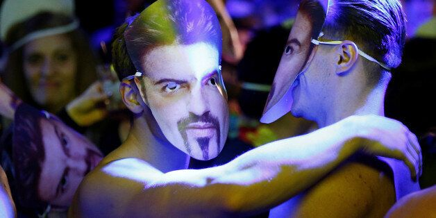 Dancers wear George Michael masks at a tribute night event in his honour, in London, Britain, January...