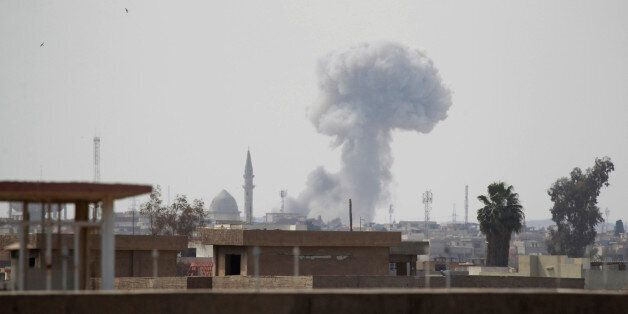 Smoke rises from clashes during a battle between Iraqi forces and Islamic State militants, in Mosul,...