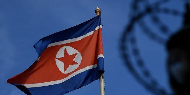 The North Korean flag is seen at mast past the barbed wire fencing of the North Korean embassy in Kuala...