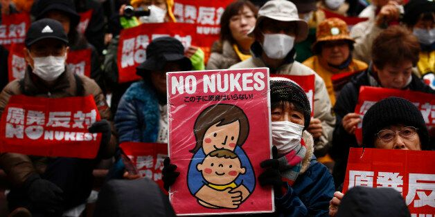 People hold placards denouncing nuclear energy during a rally in central Tokyo March 8, 2015. Anti-nuclear...