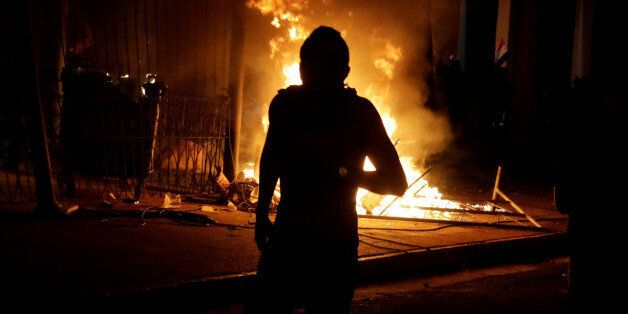 Protestors set fire to the Congress building during a demonstration against a possible change in law...