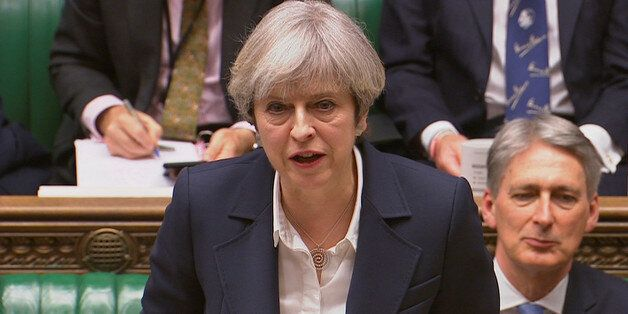 Britain's Prime Minister Theresa May speaks in Parliament as she announces that she has sent the letter...