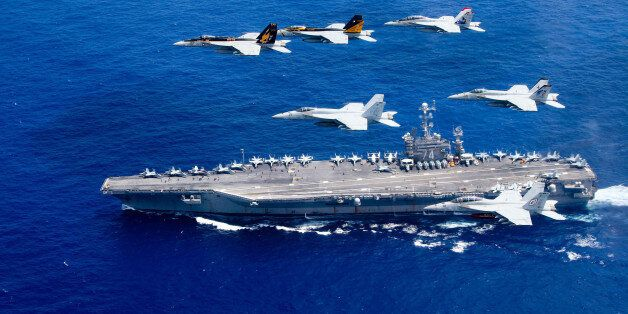 PHILIPPINE SEA - JUNE 18: In this handout provided by the U.S. Navy, a combined formation of aircraft...