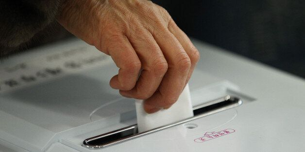 A woman casts her ballot for the presidential election at a polling station in Seoul, South Korea, on...