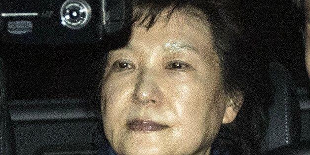 Park Geun-hye, former president of South Korea, center, leaves the Seoul Central Prosecutors' Office...