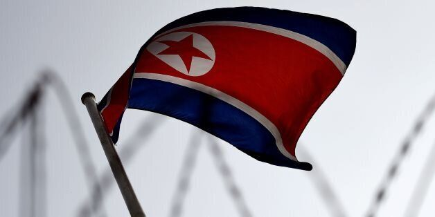 The North Korean flag is seen flying in backdrop of barbed wire at the North Korean embassy in Kuala...