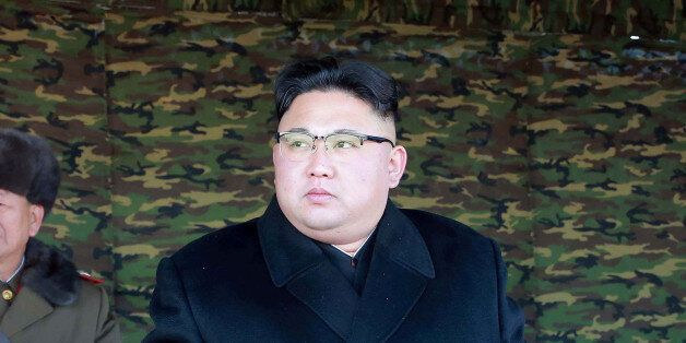 North Korean leader Kim Jong Un guides the winter river-crossing attack tactical drill of the reinforced...