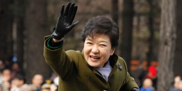 South Korea's new President Park Geun-Hye waves after her inauguration ceremony at parliament in Seoul...
