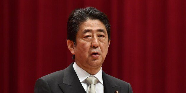 Japanese Prime Minister Shinzo Abe delivers a speech during the graduation ceremony of the National Defense...