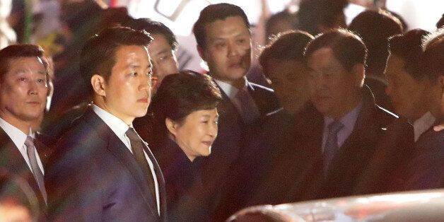 SEOUL, SOUTH KOREA - MARCH 12: Ousted South Korea President Park Geun-hye (C) smiles as she is greeted...