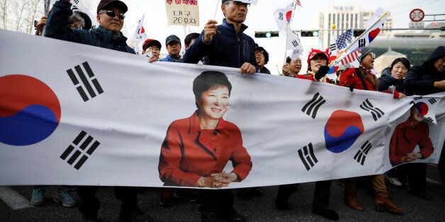 Supporters of South Korea's ousted leader Park Geun-hye march on a street during a protest in Seoul,...