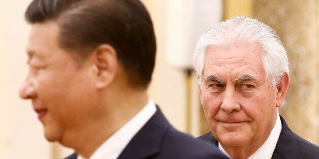 China's President Xi Jinping (L) meets US Secretary of State Rex Tillerson at the Great Hall of the People...