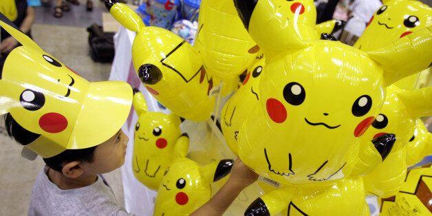 A Japanese boy chooses a Pokemon balloon during Pokemon Festa 2005 in Yokohama, south of Tokyo August...
