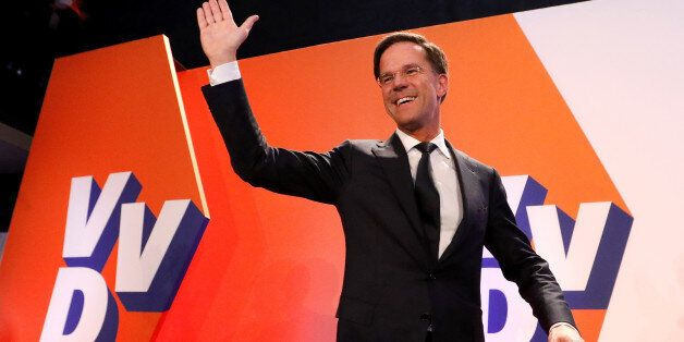 Dutch Prime Minister Mark Rutte of the VVD Liberal party appears before his supporters in The Hague,...