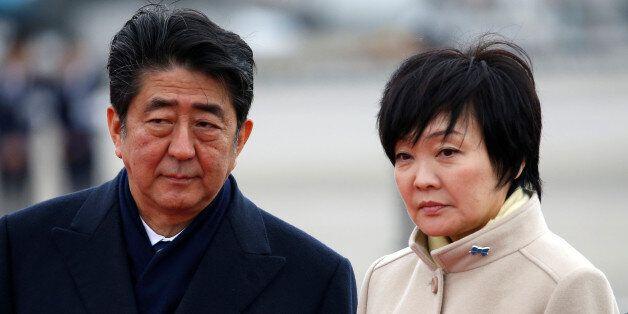 Japan's Prime Minister Shinzo Abe (L) and his wife Akie send off Emperor Akihito and Empress Michiko...