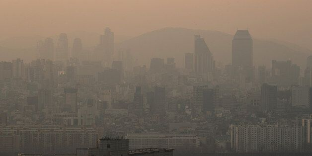 Commercial and residential buildings shrouded in haze stand in Seoul, South Korea, on Monday, March 13,...