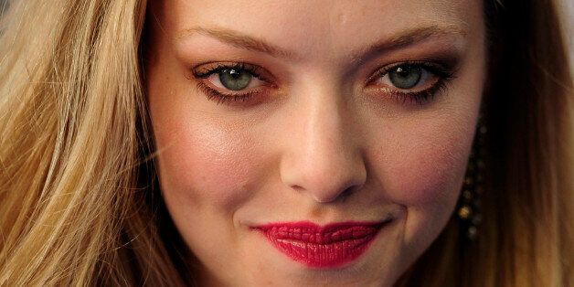 U.S. actress Amanda Seyfried poses as she arrives for the world premiere