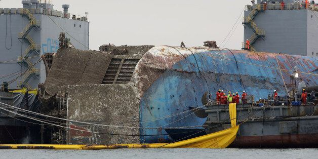 JINDO-GUN, SOUTH KOREA - MARCH 24: Submersible vessel attempts to salvage sunken Sewol ferry in waters...