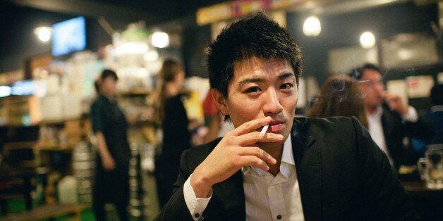 Young man smoking in Roppongi,