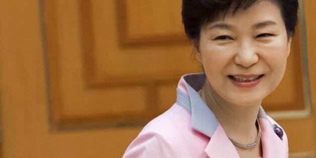 Korean President Park Geun-hye awaits the arrival of US Secretary of State John Kerry for a meeting at...