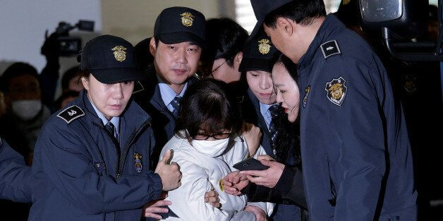 Choi Soon-sil, the jailed confidante of disgraced South Korean President Park Geun-hye, center, arrives...
