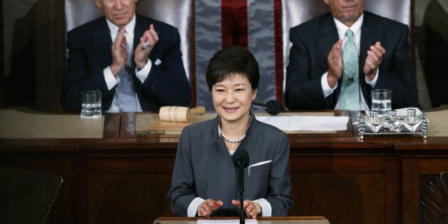 FILE PHOTO: South Korea's President Park Geun-hye is applauded by U.S. Vice President Joe Biden (L) and...