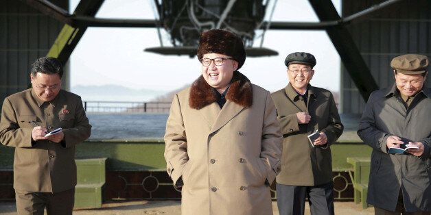 FILE PHOTO: North Korea leader Kim Jong Un smiles as he visits Sohae Space Center in Cholsan County,...