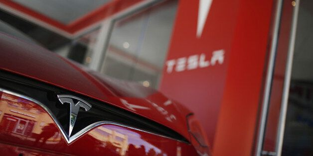 A Tesla Motors Inc. electric vehicle sits on display outside a company's store at the Easton Town Center...