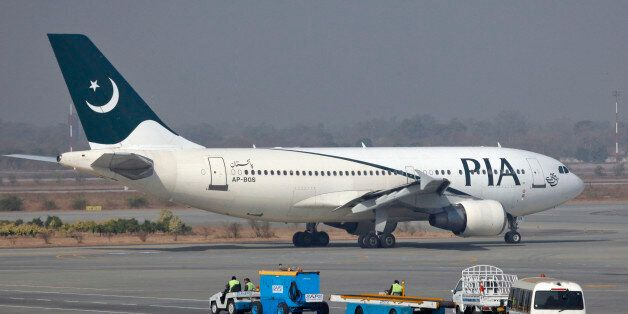 A Pakistan International Airlines (PIA) plane prepares to take-off at Alama Iqbal International Airport...