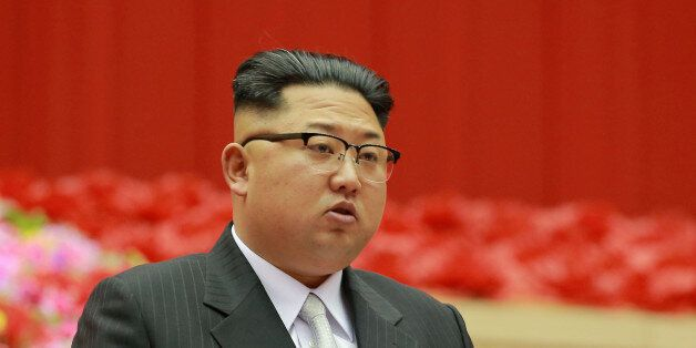 North Korean leader Kim Jong Un speaks during the first session of the first party committee meetingin...