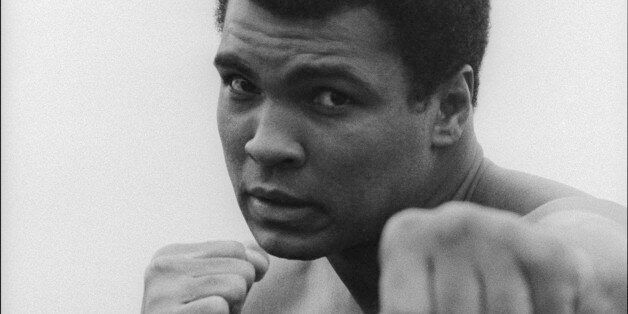 Portrait of American heavyweight boxer Muhammad Ali after a workout at his training camp, Deer Lake,...