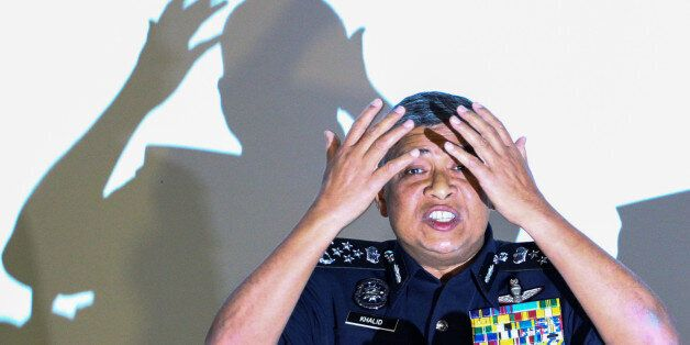Malaysia's Royal Police Chief Khalid Abu Bakar demonstrates to the media during a news conference regarding...