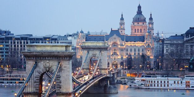 a view of the Chain Bridge in budapest early in the