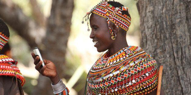 LOIYANGELENI, KENYA - May 18. A Samburu woman uses her mobile phone in Loyangalani in the north of Kenya...