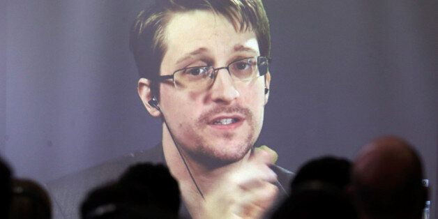 Edward Snowden speaks via video link during a conference at University of Buenos Aires Law School, Argentina,...