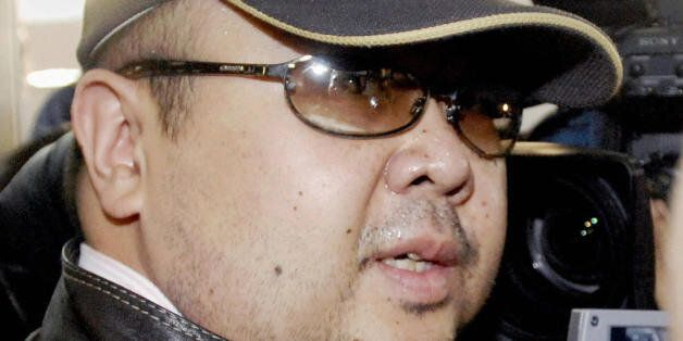 Beijing, CHINA: A man believed to be North Korean leader Kim Jong-Il's eldest son, Kim Jong-Nam, is surrounded...
