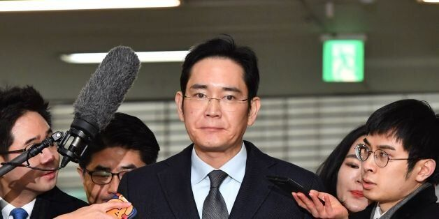 Lee Jae-yong (C), vice chairman of Samsung Electronics, arrives to be questioned as a suspect in a corruption...