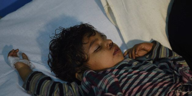 An injured child is treated at a local hospital in the town of Sehwan, a day after a bomb attack hit...