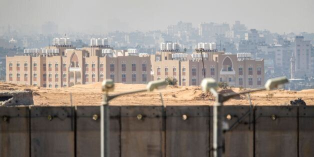 A picture taken from the southern Israel-Gaza Strip border on February 7, 2017 shows buildings in the...