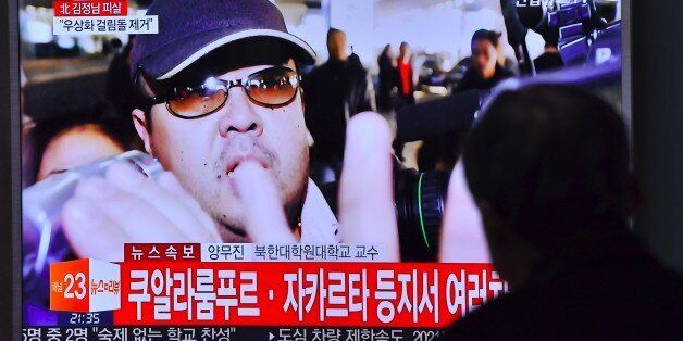 A man watches a television showing news reports of Kim Jong-Nam, the half-brother of North Korean leader...