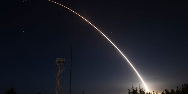 An unarmed Minuteman III intercontinental ballistic missile launches during an operational test from...