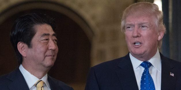 US President Donald Trump and Japanese Prime Minister Shinzo Abe pose for photos at Trump's Mar-a-Lago...