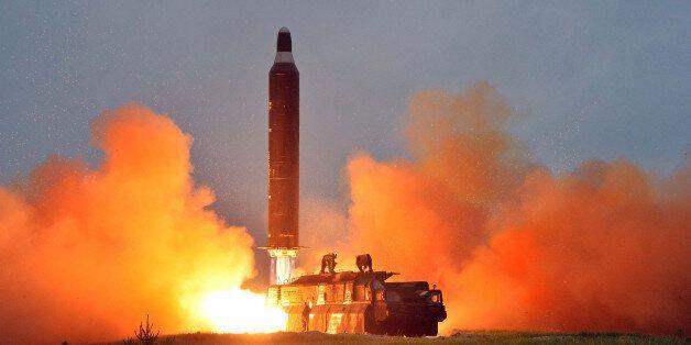 A test launch of ground-to-ground medium long-range ballistic rocket Hwasong-10 in this undated photo...