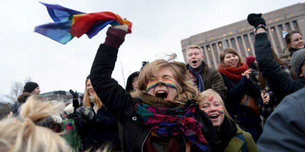 Supporters of the same-sex marriage celebrate outside the Finnish Parliament in Helsinki, Finland on...