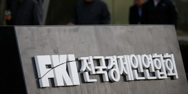 The logo of the Federation of Korean Industries (FKI) is seen at its headquarters in Seoul, South Korea,...