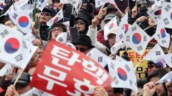 경찰, 기자 폭행 '태극기집회' 참가자 신원