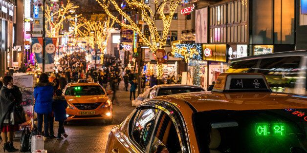 Taxi waiting for passengers in Myeongdong, a very popular place for tourists with lots of restaurants,...