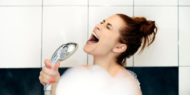 woman singing at shower
